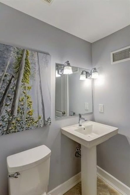 Renovated Powder Room with Pedestal Sink