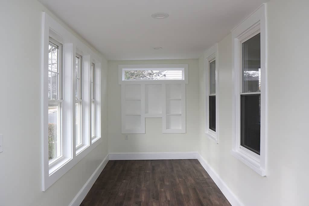 Renovated Enclosed Front Porch with Built-in Shelves