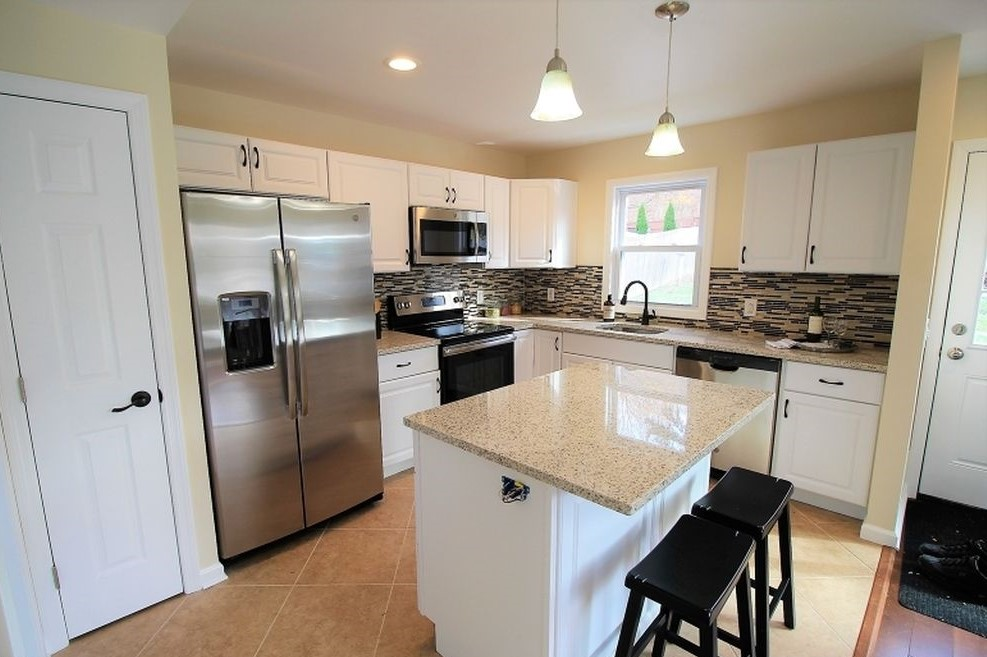 Renovated Kitchen with Island and Pantry