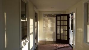 Renovated Enclosed Front Porch with Built-in Shelving