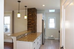 Renovated Kitchen with Breakfast Bar and Skylight