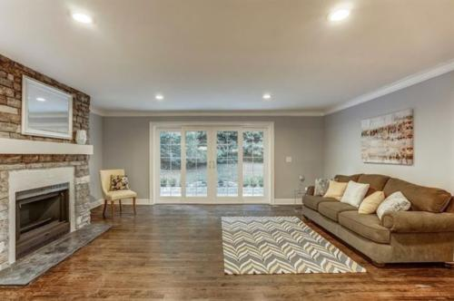 Renovated Family Room with Fireplace and French Doors to Patio