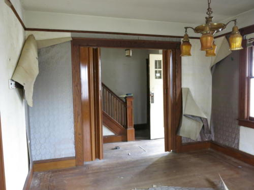 BEFORE - Living Room into Foyer and Staircase