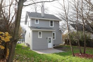 Renovated Home - Back of House with New Vinyl Siding and New Back Patio